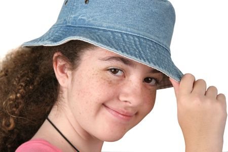 tipping: a cute teen girl tipping her hat - isolated Stock Photo