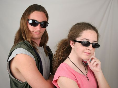 two teens wearing sunglasses and looking cool Stock Photo - 217066