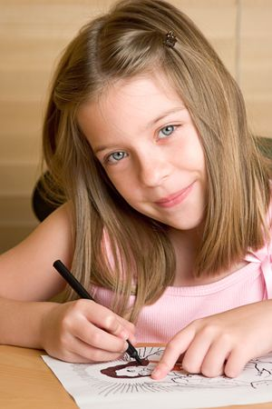 gospels: A beautiful little girl coloring a picture of Jesus Stock Photo