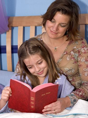 gospels: A mother and daughter reading bible stories at bedtime