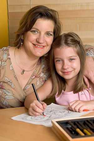 gospels: A mother and daughter sharing family time and coloring a picture of Jesus.
