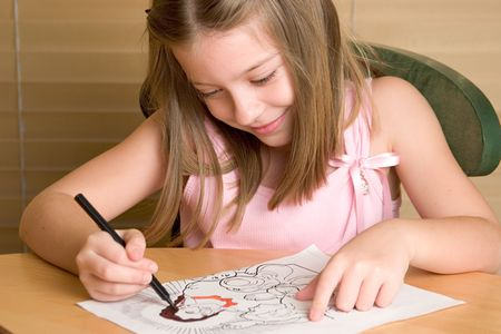 gospels: A young girl coloring in a Christian coloring book Stock Photo