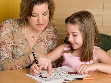 A teacher (or mother) teaching a child about jesus at Sunday school photo