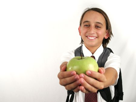 room for text: a school boy holding out an apple for the teacher - room for text