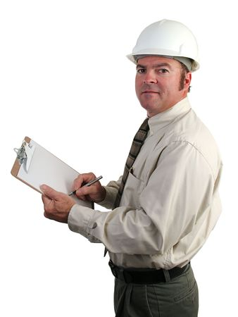 engineering clipboard: A construction engineer taking notes on the job