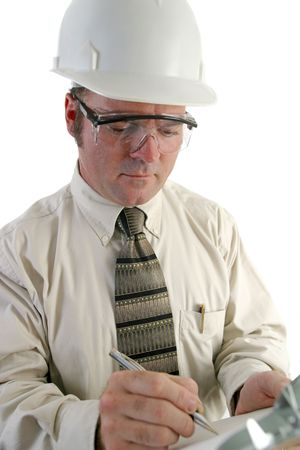 a closeup of an engineer, wearing safety goggles, and writing on a clipboard. Isolated