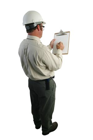 engineering clipboard: A construction safety inspector marking his checklist - full, over-the-shoulder view