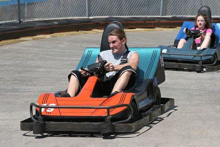 teenaged boys: two teenagers racing go carts