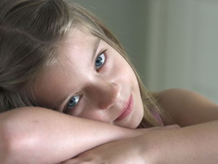 peacefulness: a pretty little girl resting her head on her hands