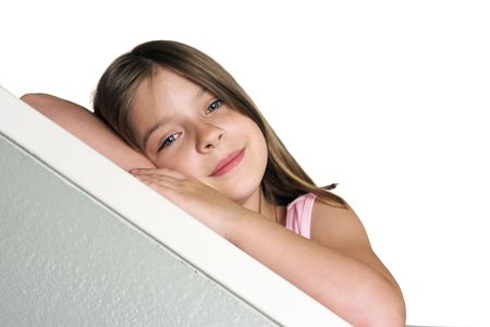 room for text: a little girl leaning on a bannister - Room for Text Stock Photo
