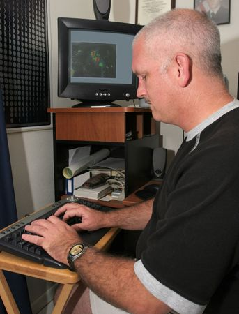 A meteorologist tracking a hurricane on his computer Stock Photo - 1406829