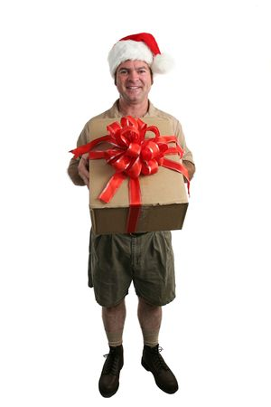 A full view of a delivery man with a Santa hat delivering a gift - isolated photo