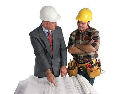 jobsite: an engineer explaining the blueprints to a construction foreman - isolated Stock Photo