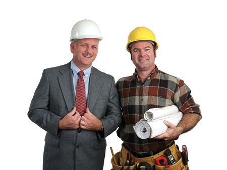 an engineer and a contractor posing together with blueprints
