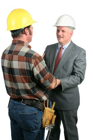 warmly: two construction workers greeting eachother warmly and sharing a moment of fellowship - isolated