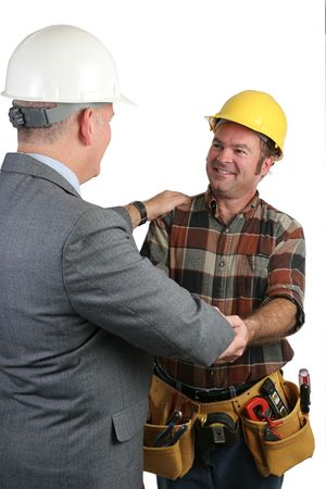 jobsite: Two workmen sharing fellowship on the jobsite.