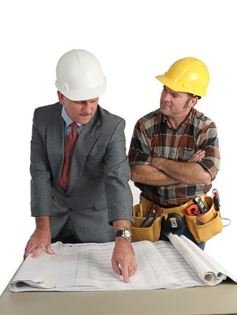 an engineer explaining the blueprints to the construction foreman - isolated photo