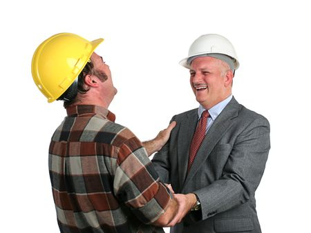 an engineer and a construction foreman sharing a joke together at work - isolated photo