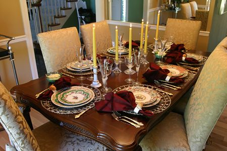holiday meal: a table set with fine china and candles for the holiday meal