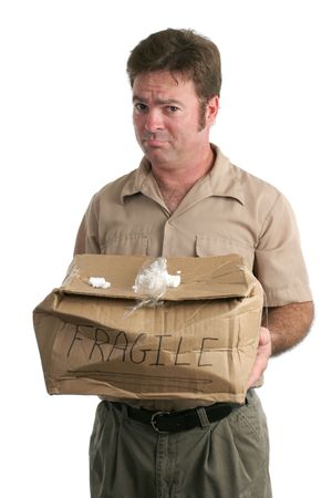 smashed: A delivery man holding out a smashed package and looking very sorry.  Isolated.