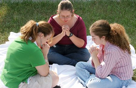 teenaged girls: A group of teen girls gathered for prayer.