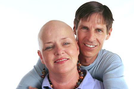 A loving, devoted couple.  The wife is undergoing cancer treatment. photo