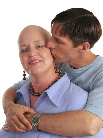 A woman undergoing chemotherapy and her supportive, loving husband. Stock Photo