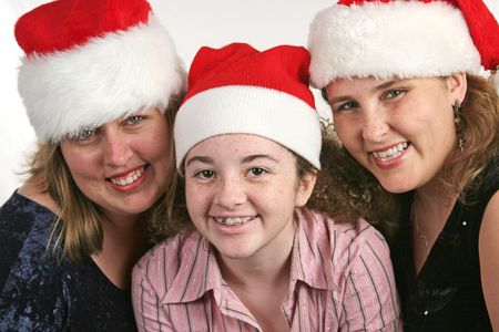 age related: Three cute cousins with Christmas hats on.