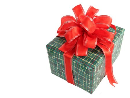 room for text: A green wrapped Christmas gift with a red bow, isolated with room for text. Stock Photo