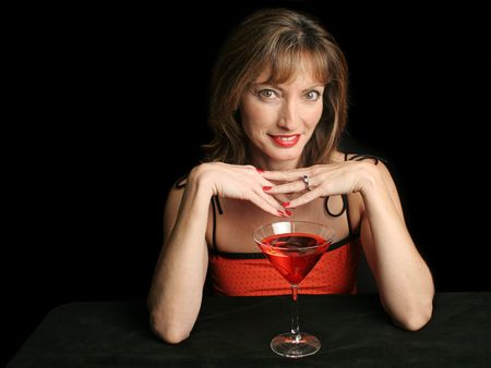 A beautiful woman on a date, drinking a cosmopolitan and enjoying an interesting conversation. photo