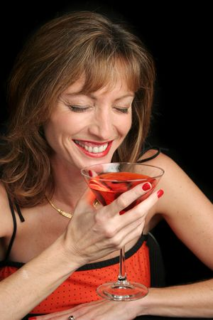 A beautiful woman laughing over a coctail. photo