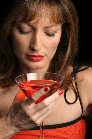 A beautiful woman, drinking alone. photo