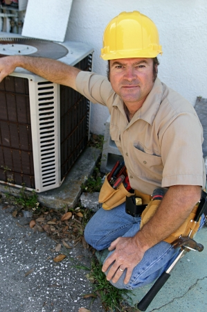 A handsome, competent looking air conditioning repairman