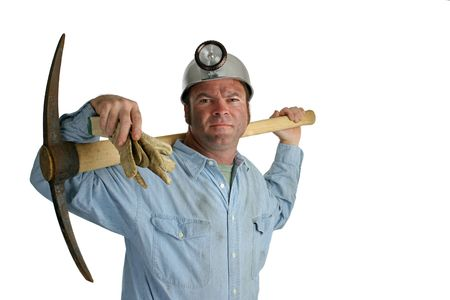 A coal miner with a pickax resting on his shoulders - isolated. photo