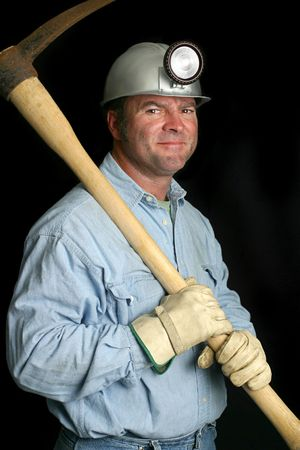 A friendly coal miner with his pick ax over his shoulder. photo