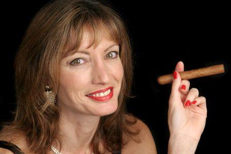 sophistication: A cute woman smoking a big cigar.