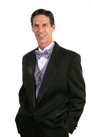 acomodador: Un hombre apuesto, ya sea un esposo o una fecha a un evento formal.  Foto de archivo