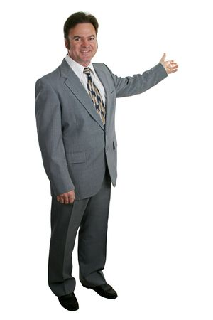 A businessman or realtor isolated, gesturing toward a chart or home. Stock Photo - 277489