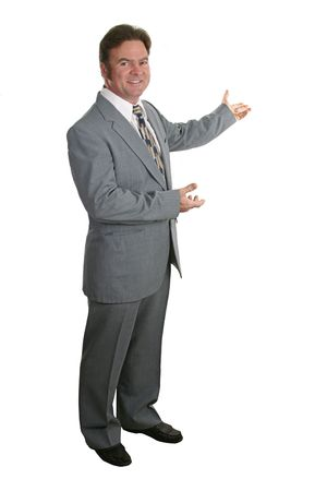 toward: A businessman or realtor gesturing with both hands toward a chart or home - isolated.