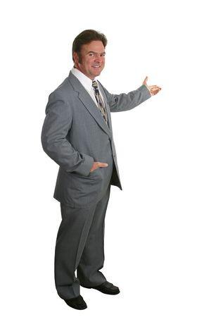 lecturing: A businessman or realtor with one hand in his pocket and the other gesturing toward a chart or home.