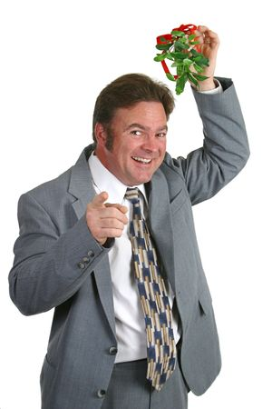 A businessman under the mistletoe pointing at you. photo