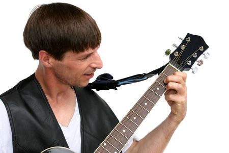 fingering: A good-looking guy playing guitar - isolated.