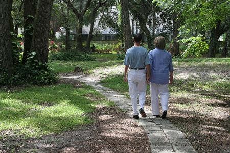 A couple walking together on garden path. photo