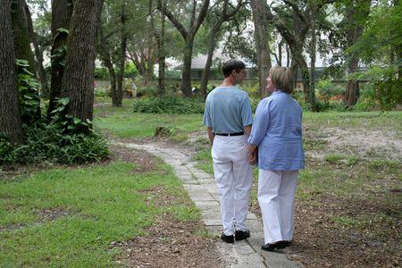 stroll: A couple taking a romantic stroll through the garden.