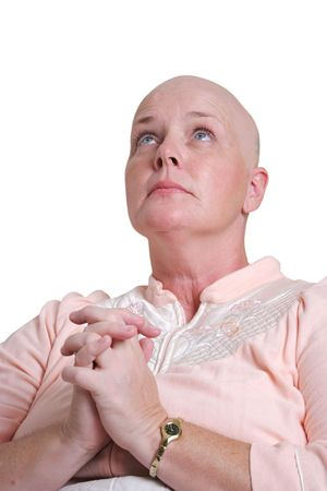 cancer patient: A medical patient praying and looking to God for healing. Stock Photo