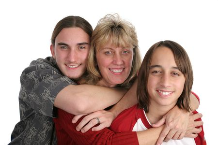 teenaged boys: An attractive mother and her two teen sons, isolated.