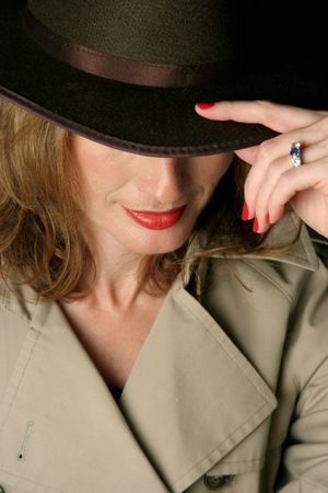 fedora: A beautiful, sexy woman in a trenchcoat and fedora hat.  Her eyes are concealed beneath the brim of the hat.