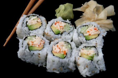 california roll: A california roll shushi isolated on black background, with chopsticks and wasabi Stock Photo
