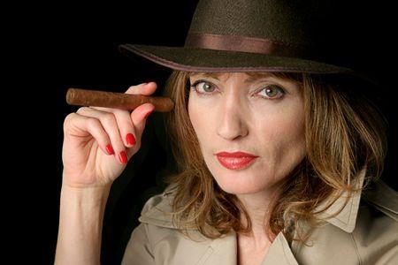 A beautiful dangerous spy woman holding a cigar