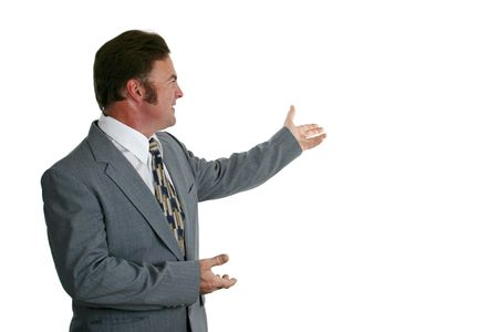 A businessman in a gray suit gesturing toward a chart or graph. Isolated. Stock Photo - 305890